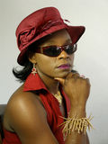 Black woman wearing red hat hand on chin Stock Photography