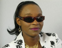 Black woman wearing sunglasses. Smiling to the camera stock photo