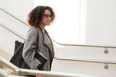 Black woman well casual dressed walking in the city stock photography