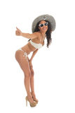 Black woman in white bikini with straw hat. Black woman hitchhiking in bikini with straw summer hat and sunglasses isolated over white background Stock Images