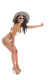 Black woman in white bikini with straw hat. Black woman hitchhiking in bikini with straw summer hat and sunglasses isolated over white background Stock Photography