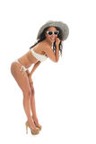 Black woman in white bikini with straw hat. Black woman in bikini with straw summer hat and sunglasses isolated over white background Royalty Free Stock Images