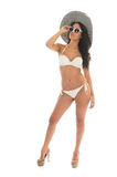 Black woman in white bikini with straw hat. Black woman in bikini with straw summer hat and sunglasses isolated over white background Royalty Free Stock Image