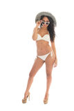 Black woman in white bikini with straw hat. Black woman in bikini with straw summer hat and sunglasses isolated over white background Stock Image