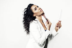 Black woman in a white suit doing make up. Black woman in a white suit doing Stock Images