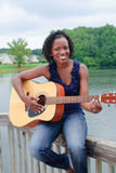 Black Woman With Guitar Stock Photo