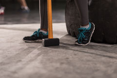 Black woman after workout with hammer with focus on legs Stock Image
