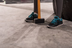 Black woman after workout with hammer with focus on legs Royalty Free Stock Photos