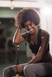 Black woman after workout with hammer Royalty Free Stock Images