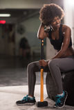 Black woman after workout with hammer Stock Images