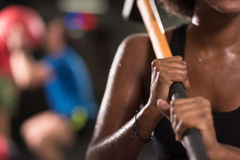Black woman after workout with hammer Royalty Free Stock Photography