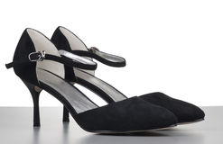 Black womanish shoes from a shammy Stock Photos
