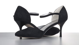 Black womanish shoes from a shammy Stock Photo