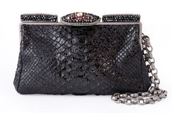 Black women bag. Black female crocodile bag isolated on white background with clipping path Royalty Free Stock Photos