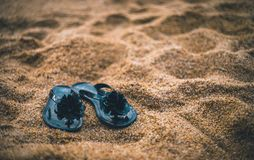 Black women flip flops on beach sand royalty free stock photos