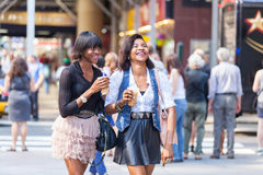 Black Women in New York. Two Beautiful Black Woman Enjoying Refreshing Drinks in New York Stock Photos