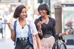 Black Women in New York. Two Beautiful Black Woman Walking in New York stock image