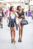 Black Women in New York. Two Beautiful Black Woman Walking in New York royalty free stock image