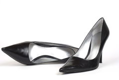 Black Women's High-Heel Shoes 2. A pair of black women's high-heel shoes against a white background, one shoe standing, one shoe lying on side Stock Photo