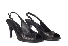 Black Women's High-Heel Shoes 2. A shot of two black women's high-heel dress shoes against white background Stock Photos