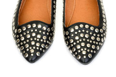 Black women's leather ballet flats with steel rivets close up Royalty Free Stock Photo