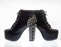 Black women`s shoes with studs on a white background stock photography
