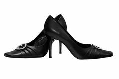 Black women's shoes on a white background Stock Images