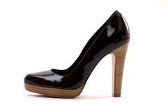 Black women shoe. On white stock photography
