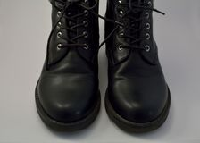 A black women shoes. A black women`s boots for spring and autumn with laces stock photography