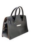Black womens bag  on white background. Royalty Free Stock Photo