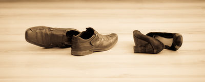 Black womens and mens shoes. On the floor Stock Photography