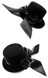 Black womens top hats with bows. Pair of feminine black top hats with satin bows isolated on white background Royalty Free Stock Photos