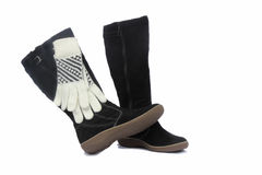 Black womens winter boots and white gloves. Royalty Free Stock Photo