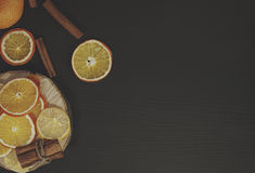 Black wood background with slices of orange and lemon Royalty Free Stock Photography