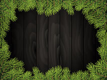 Black Wood Board Background With Pine Twig Border. Royalty Free Stock Photography