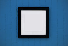 Black wood frame on the wall Stock Photography