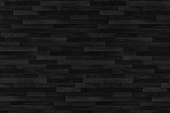 Black wood parquet texture. Background old panels. Stock Image