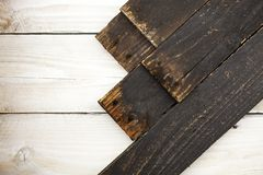 Black wood plank on white wooden texture background. stock image