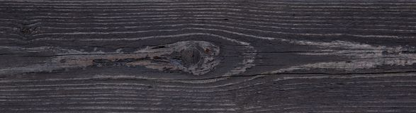 Black wooden abstract background with light and scratches, dark wood texture.  Royalty Free Stock Photos