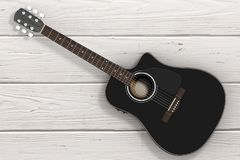 Black Wooden Acoustic Guitar. 3d Rendering. Black Wooden Acoustic Guitar on a wooden table. 3d Rendering Royalty Free Stock Photo