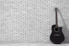 Black Wooden Acoustic Guitar. 3d Rendering. Black Wooden Acoustic Guitar in front of brick wall. 3d Rendering Stock Photography