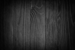 Black wooden background or gloomy wood grain texture. Old black wood. Blackboard. Dark background/ Grunge gloomy wooden texture stock photos