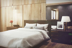 Black and wooden bedroom, mirror, side toned Stock Photos