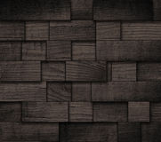 Black wooden blocks texture. Surface of wall. Stock Images