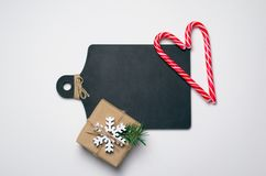 Black Wooden Board, Christmas Present and Candy Cane, Free Space for Text, Holidays Concept. Black Wooden Board, Christmas Present and Candy Cane, Free Space for stock photography