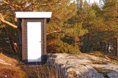 Black wooden building toilets Royalty Free Stock Photos