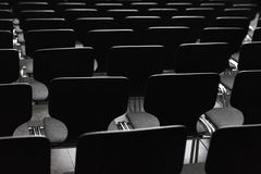 Black wooden chairs in rows royalty free stock photo