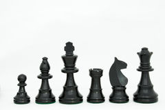 Black wooden chess pieces Stock Images