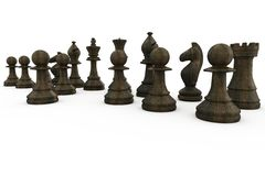 Black wooden chess pieces standing Royalty Free Stock Photo