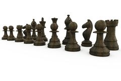 Black wooden chess pieces standing Royalty Free Stock Photos